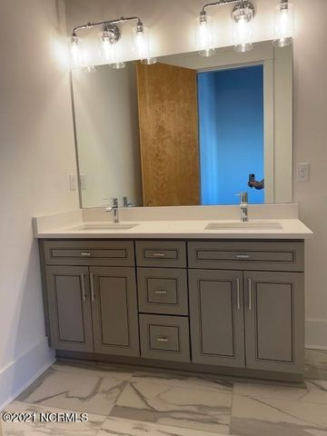 Photo of the double vanity in the master bath Indie Ice Lofts