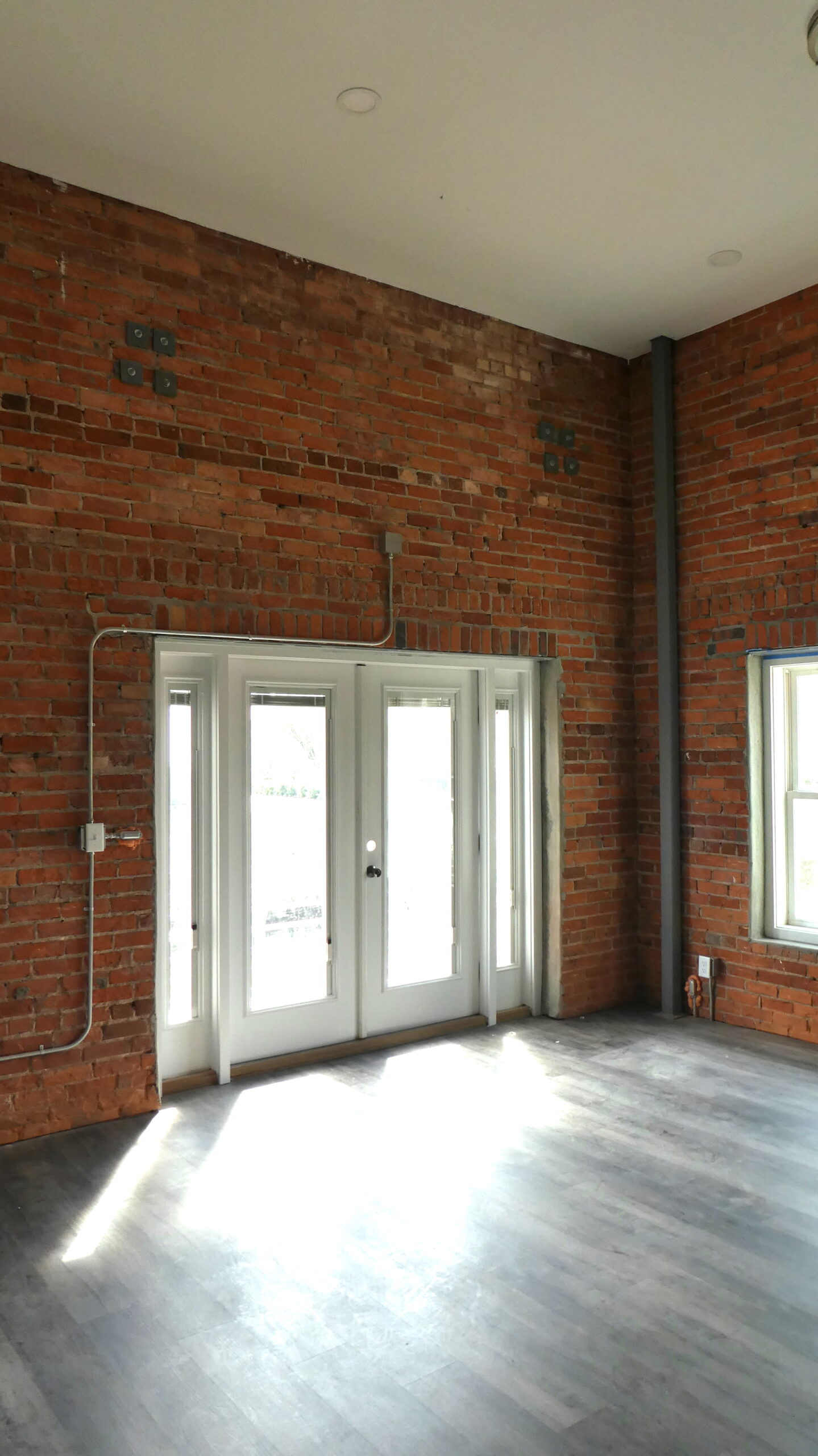 Photo of the French doors from the living room to the patio in an Indie Ice Loft unit