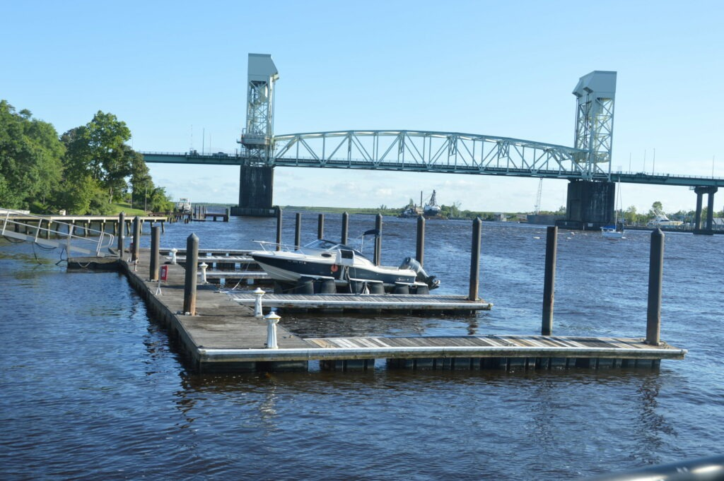 Photo of the boat slips at Governors Landing with the Cape Fear Memorial Bridge in the background