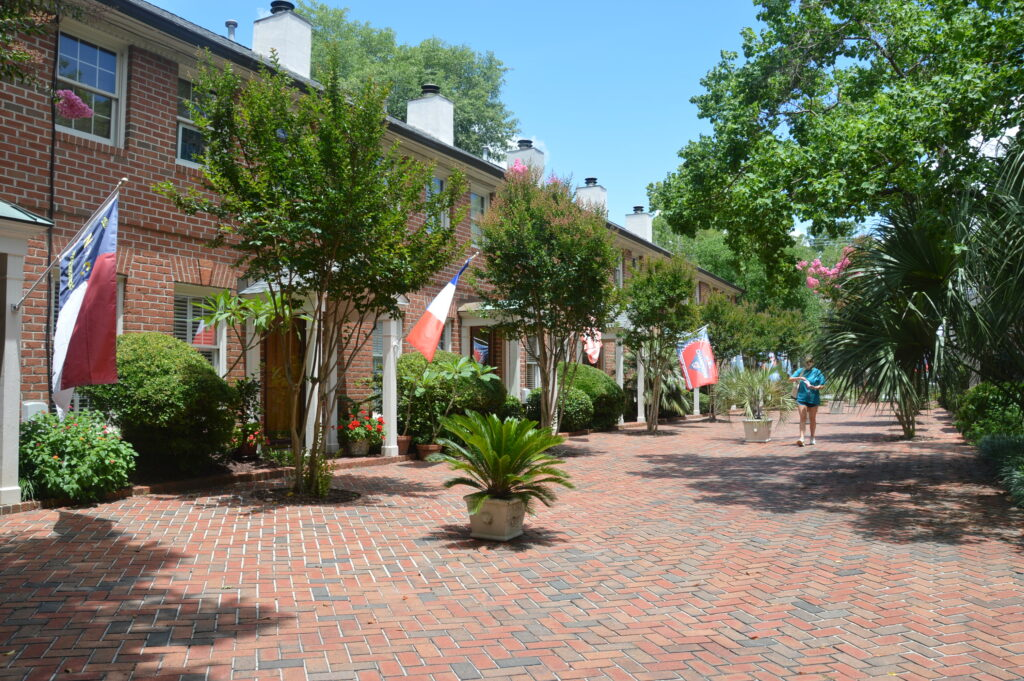 Photo of the red brick courtyard and row of condominiums at Wilmington Square