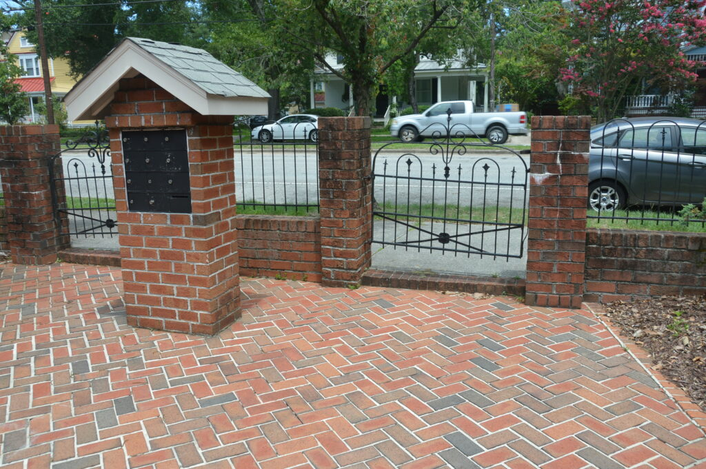 Photo of the mail boxes and gate leading to 3rd Street at Wilmington Square Condominiums