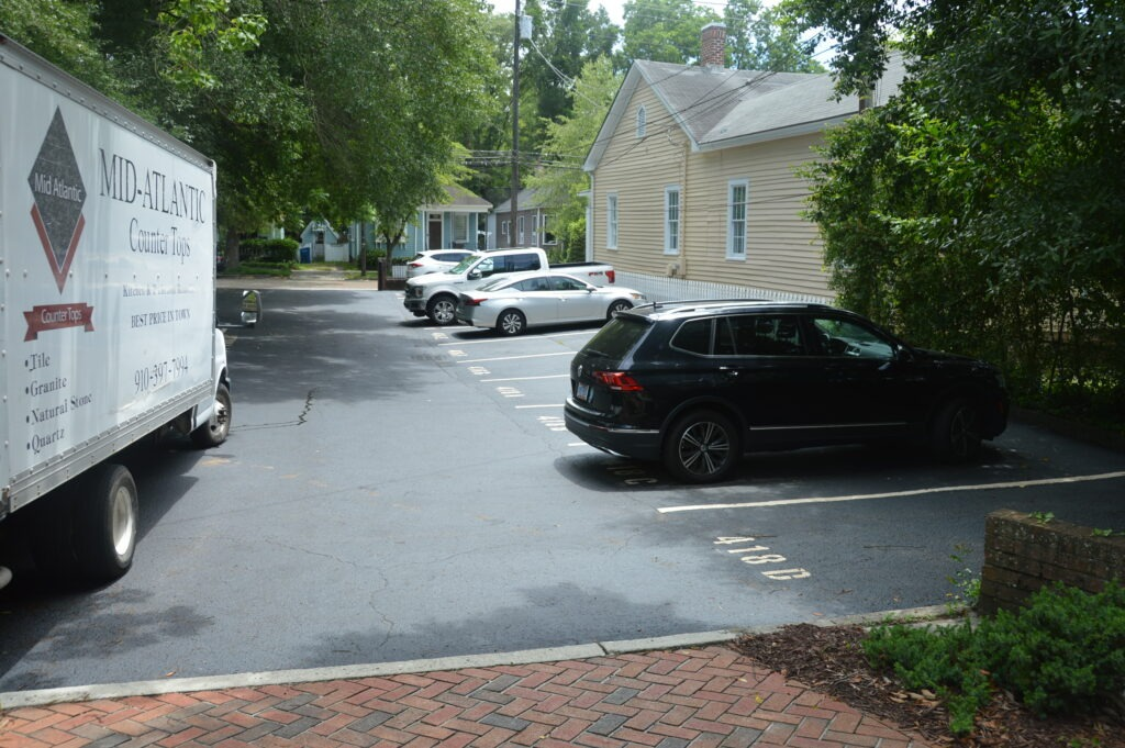 Photo of cars in assigned parking area for Wilmington Square Condominiums