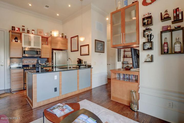 Detail of smaller unit showing built in cabinets in living room