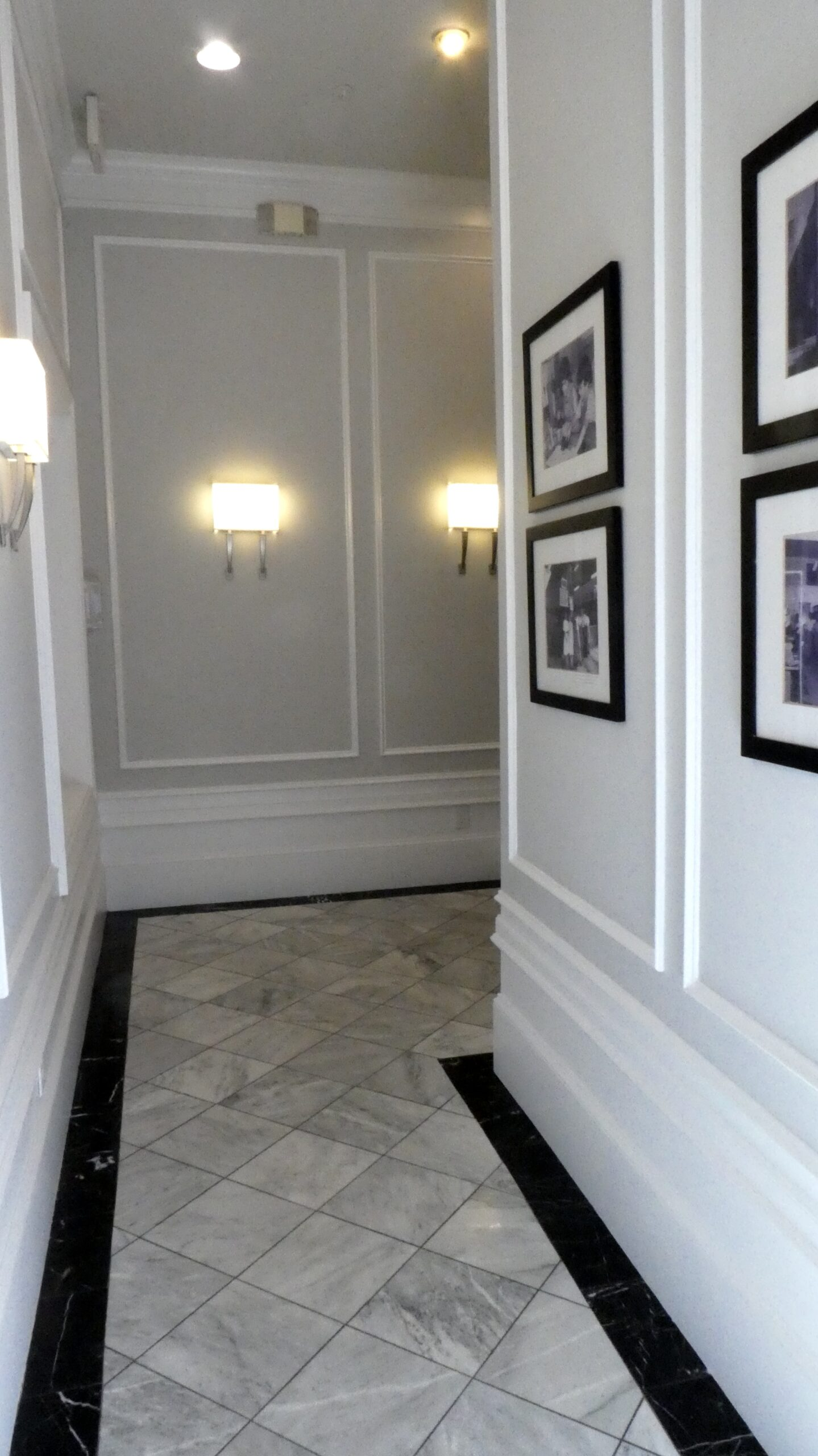 Detail of the entry hallway of the New York Hatters building showing marble tiles and wainscoting