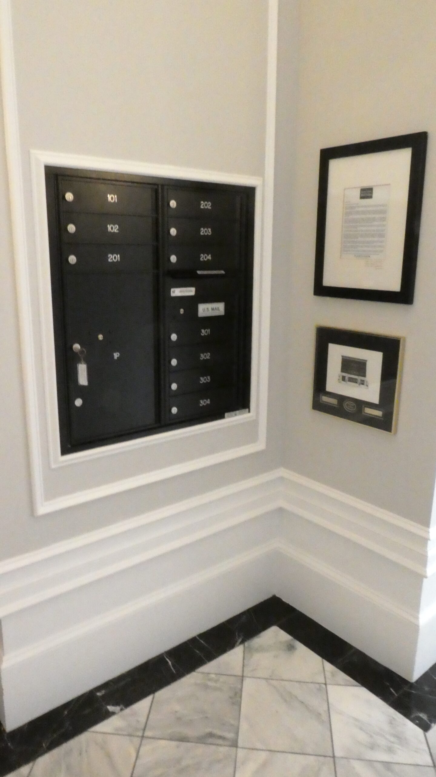 Ground floor hallway of the New York Hatters building showing resident mailboxes