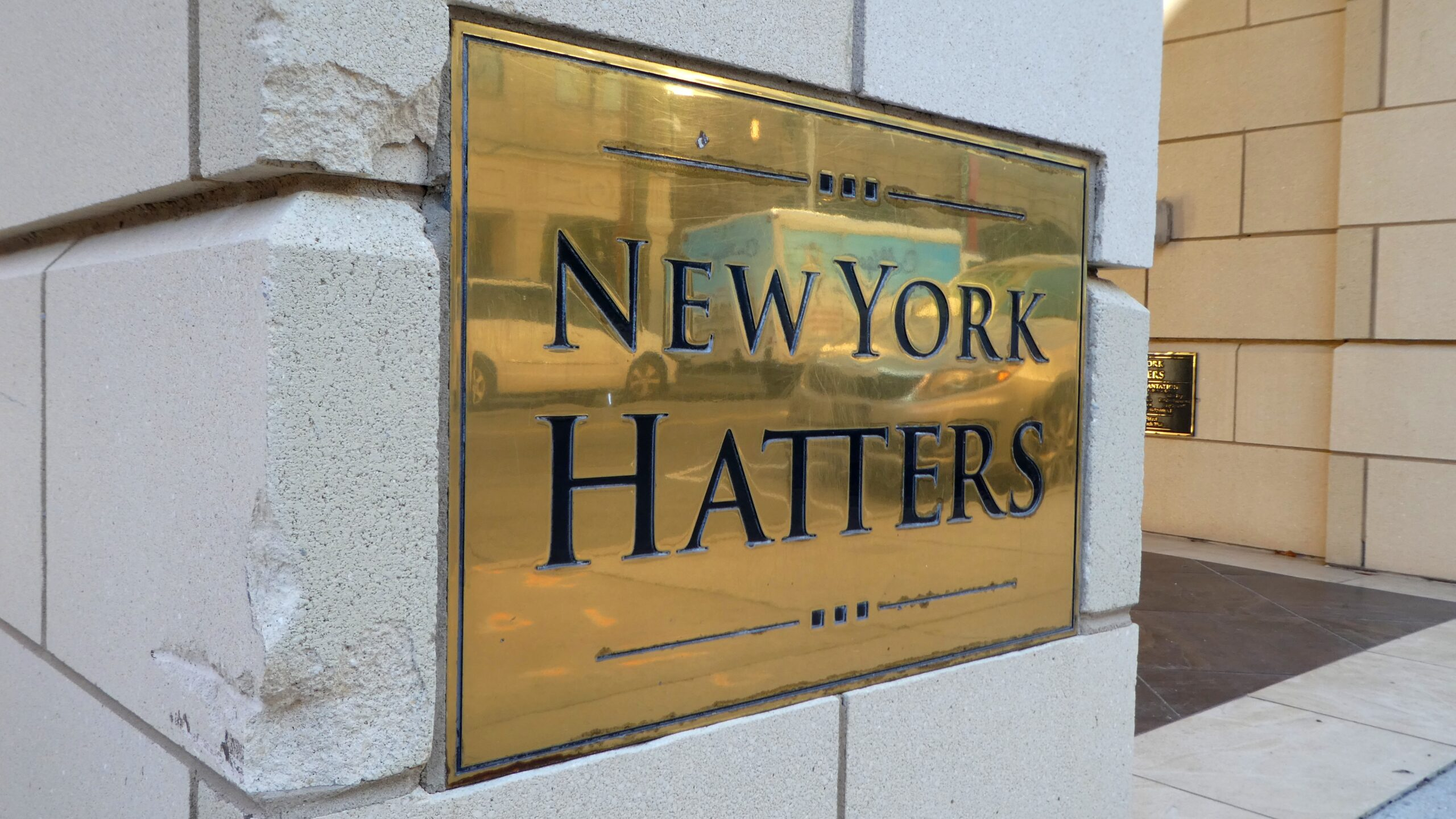Blass Nameplate attached to the front of the building with the Name New York Hatters